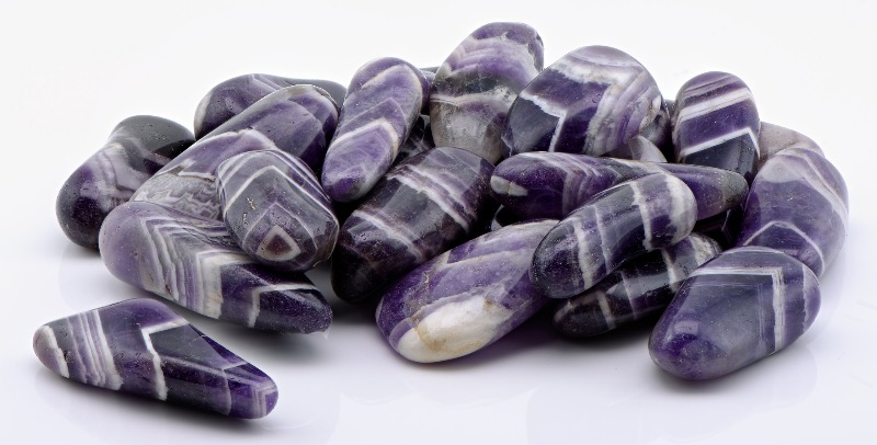 Tumbled amethyst, highlighting the banding of the stone.