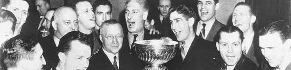 The Ranger's management team with the Stanley Cup
